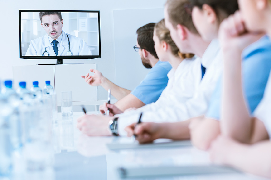 healthcare professionals having a video conference with a doctor